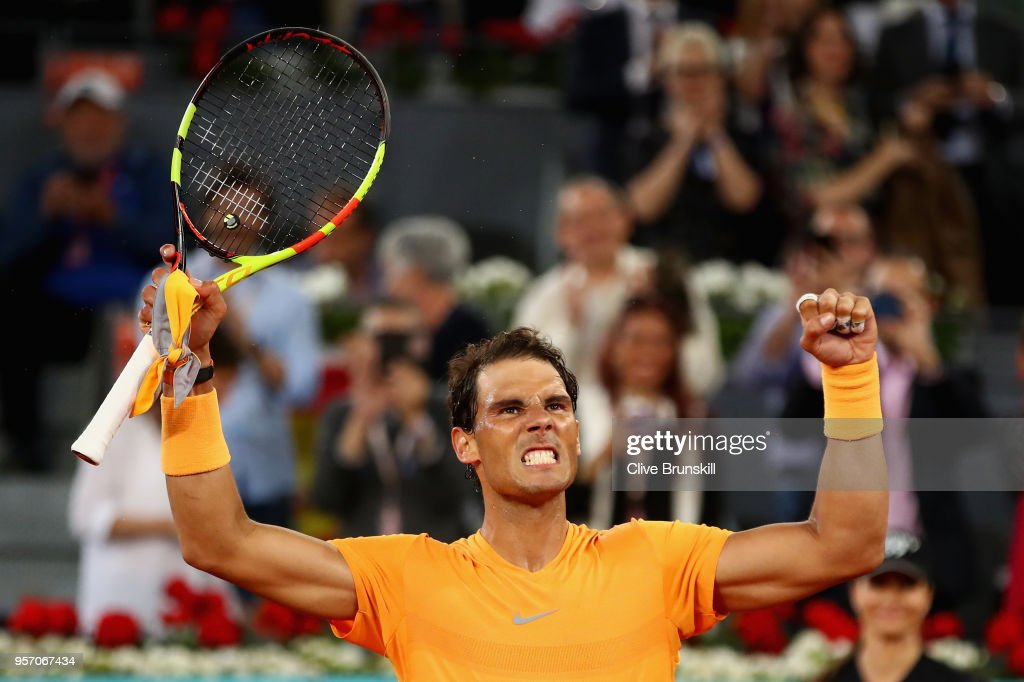 Rafael Nadal of Spain celebrates to the crowd after his straight set victory against Diego Schwartzman of Argentina in their third round match during day six of the Mutua Madrid Open tennis tournament at the Caja Magica on May 10, 2018 in Madrid, Spain.