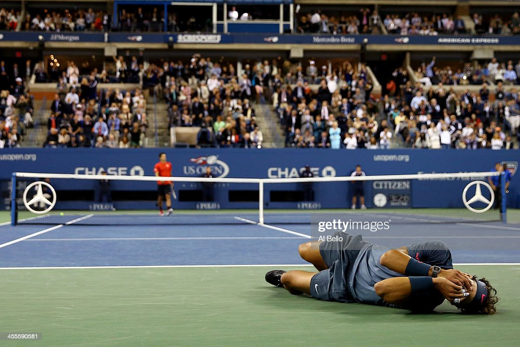 Rafael Nadal of Spain celebrates victory as Novak Djokovic of Serbia walks back to his chair after their men's singles final match against Novak Djokovic of Serbia on Day Fifteen of the 2013 US Open at the USTA Billie Jean King National Tennis Center on September 9, 2013 in the Flushing neighborhood of the Queens borough of New York City.