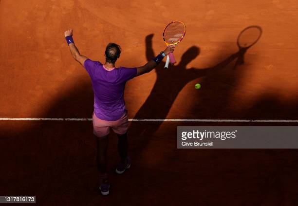 Rafael Nadal of Spain celebrates victory by smashing the ball into the stands in their mens singles third round match against Denis Shapovalov of...