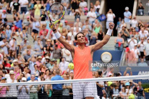 Rafael Nadal of Spain celebrates victory during his men's singles fourth round match against Nikoloz Basilashvili of Georgia on Day Seven of the 2018...