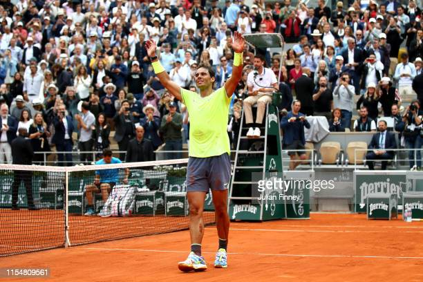 Rafael Nadal of Spain celebrates victory following the mens singles final against Dominic Thiem of Austria during Day fifteen of the 2019 French Open...