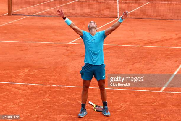 Rafael Nadal of Spain celebrates victory following the mens singles final against Dominic Thiem of Austria during day fifteen of the 2018 French Open...