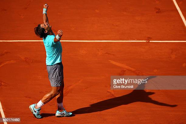 Rafael Nadal of Spain celebrates victory in his men's singles match against Andy Murray of Great Britain on day thirteen of the French Open at Roland...