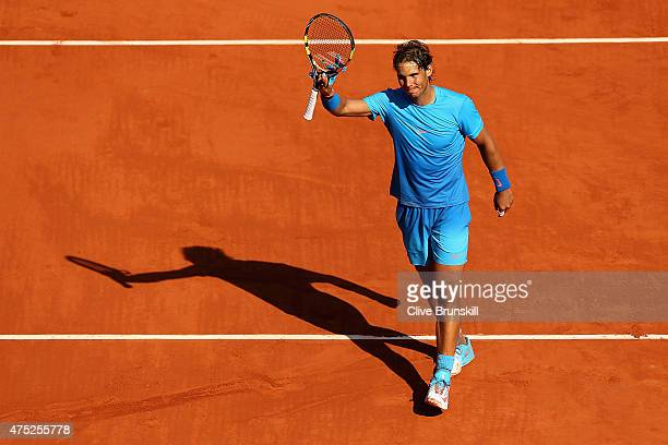 Rafael Nadal of Spain celebrates victory in his Men's Singles match against Andrey Kuznetsov of Russia on day seven of the 2015 French Open at Roland...