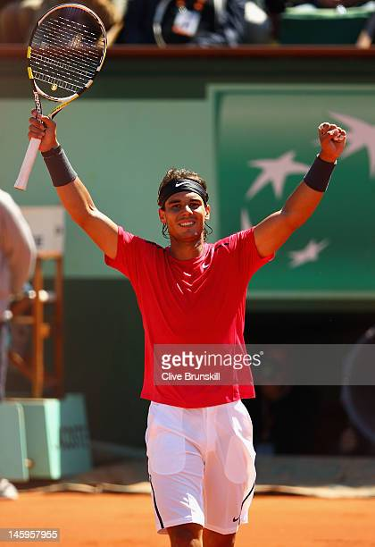 Rafael Nadal of Spain celebrates victory in his men's singles semi final match against David Ferrer of Spain during day 13 of the French Open at...
