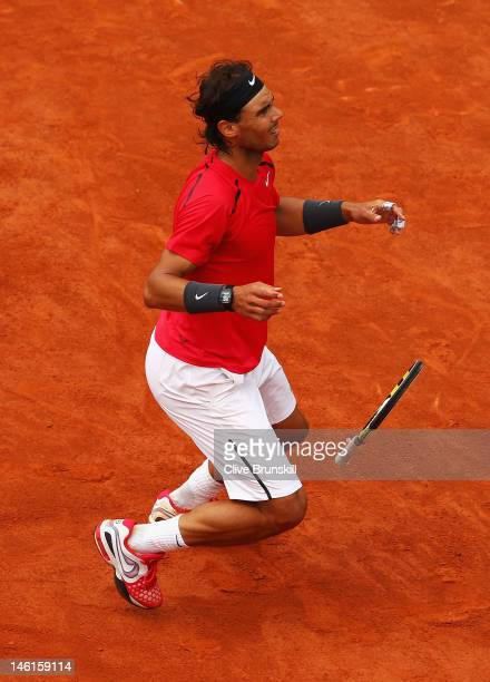 Rafael Nadal of Spain celebrates victory in the men's singles final against Novak Djokovic of Serbia during day 16 of the French Open at Roland...