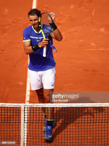 Rafael Nadal of Spain celebrates victory over Benoit Paire of France in the mens singles first round match on day two of the 2017 French Open at...