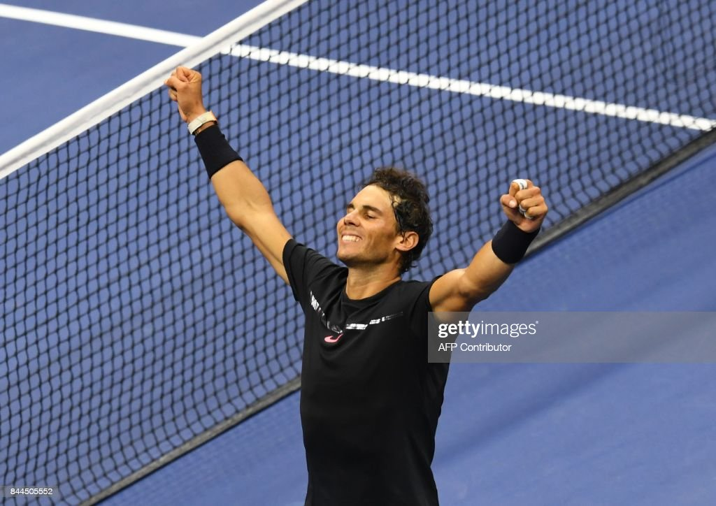 TOPSHOT - Rafael Nadal of Spain celebrates victory over Juan Martin del Potro of Argentina in their 2017 US Open Men's Singles semifinals match at the USTA Billie Jean King National Tennis Center in New York on September 8, 2017. /