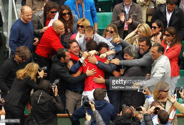 Rafael Nadal of Spain celebrates victory with friends and family after the men's singles final against Novak Djokovic of Serbia during day 16 of the...