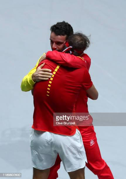 Rafael Nadal of Spain celebrates victory with team mate Roberto Bautista Agut following his singles final match against Denis Shapovalov of Canada...