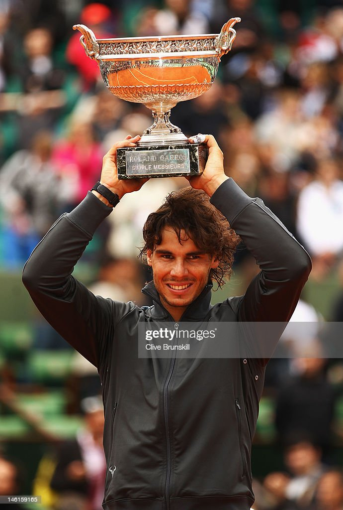 Rafael Nadal of Spain celebrates victory with the Coupe des Mousquetaires trophy in the men's singles final against Novak Djokovic of Serbia during day 16 of the French Open at Roland Garros on June 11, 2012 in Paris, France.