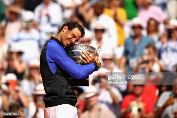 Rafael Nadal of Spain celebrates victory with the trophy following the mens singles final against Stan Wawrinka of Switzerland on day fifteen of the...