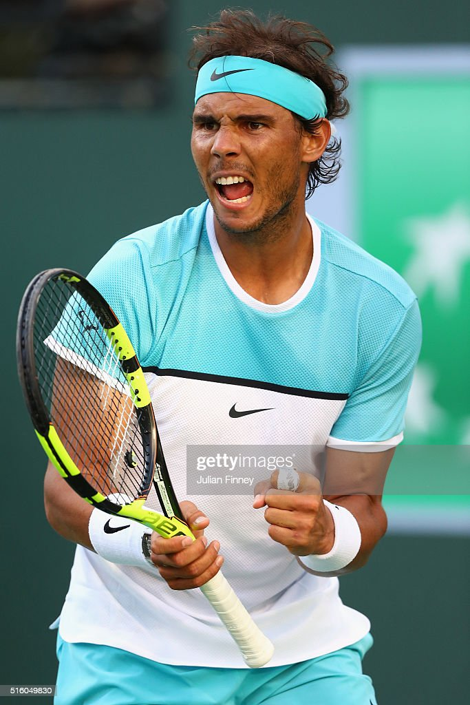 Rafael Nadal of Spain celebrates winning a game against Alexander Zverev of Germany in three sets during day ten of the BNP Paribas Open at Indian Wells Tennis Garden on March 16, 2016 in Indian Wells, California.