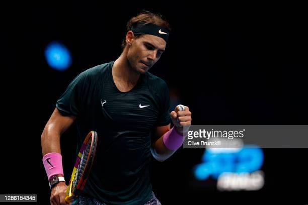 Rafael Nadal of Spain celebrates winning a point during his singles match against Dominic Thiem of Austria during day three of the Nitto ATP World...