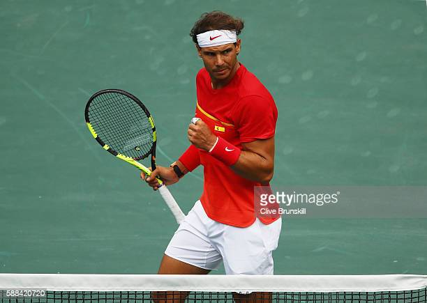 Rafael Nadal of Spain celebrates winning a point during the men's singles third round match against Gilles Simon of France on Day 6 of the 2016 Rio...