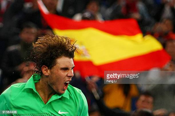 Rafael Nadal of Spain celebrates winning against James Blake of USA in his second round match during day seven of the 2009 China Open at the National...