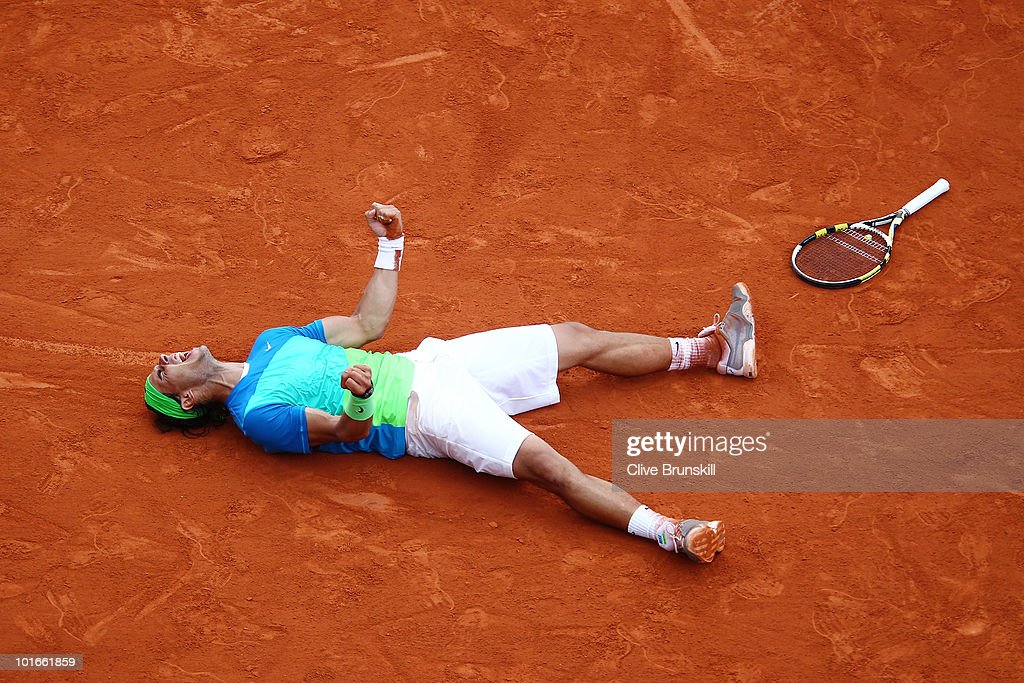 Rafael Nadal of Spain celebrates winning championship point during the men's singles final match between Rafael Nadal of Spain and Robin Soderling of Sweden on day fifteen of the French Open at Roland Garros on June 6, 2010 in Paris, France.
