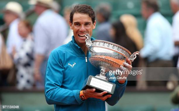 Rafael Nadal of Spain celebrates winning his 11th French Open during the trophy ceremony on Day 15 of the 2018 French Open at Roland Garros stadium...