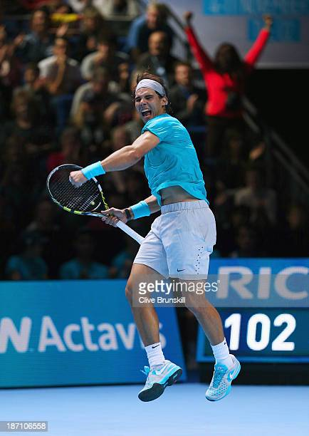 Rafael Nadal of Spain celebrates winning his men's singles match against Stanislas Wawrinka of Switzerland during day three of the Barclays ATP World...