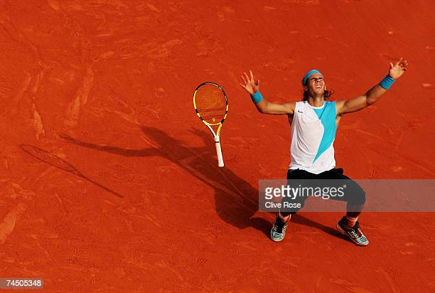 Rafael Nadal of Spain celebrates winning match point against Roger Federer of Switzerland during the Men's Singles Final on day fifteen of the French...