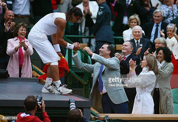 Rafael Nadal of Spain celebrates winning the Championship with Crown Prince Felipe of Spain and Princess Letizia of Spain during the men's singles...