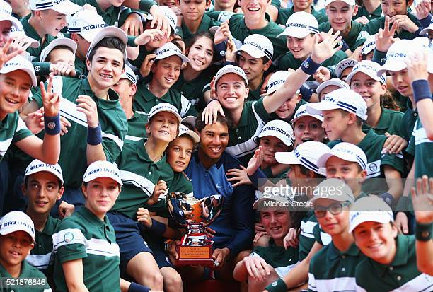 Rafael Nadal of Spain celebrates with ball boys and girls after victory in the singles final match against Gael Monfils of France during day eight of...