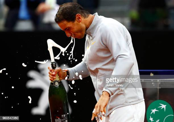 Rafael Nadal of Spain celebrates with champagne after defeating Alexander Zverev of Germany in the final during day eight of the Internazionali BNL...