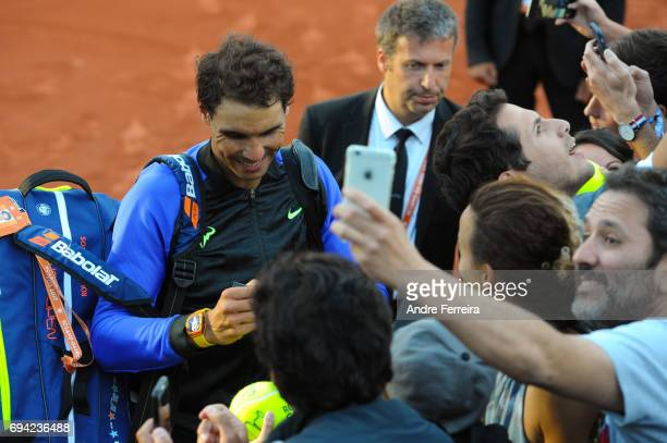 Rafael Nadal of Spain celebrates with fans during the day 13 of the French Open at Roland Garros on June 9 2017 in Paris France