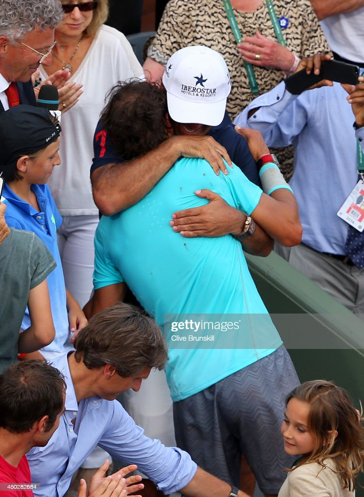 Rafael Nadal of Spain celebrates with his coach and uncle Toni Nadal after his men's singles final match against Novak Djokovic of Serbia on day fifteen of the French Open at Roland Garros on June 8, 2014 in Paris, France.