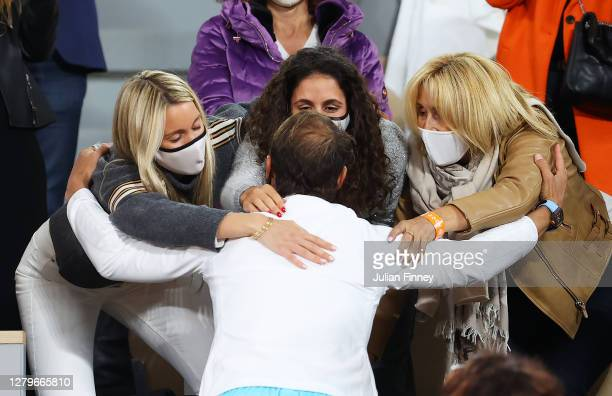 Rafael Nadal of Spain celebrates with his sister Maria Isabel Nadal, wife Maria Francisca Perello and mother Ana Maria Parera following victory in...
