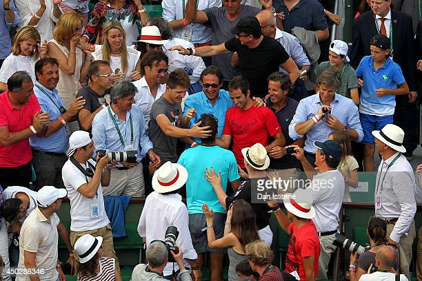 Rafael Nadal of Spain celebrates with his team and family in his player's box after his men's singles final match against Novak Djokovic of Serbia on...
