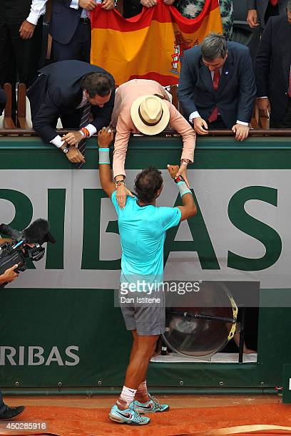 Rafael Nadal of Spain celebrates with Princess Elena of Spain after his men's singles final match against Novak Djokovic of Serbia on day fifteen of...