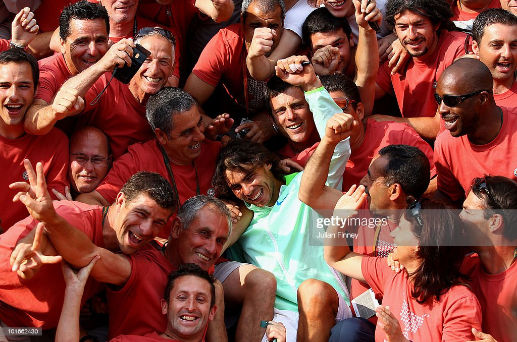 Rafael Nadal of Spain celebrates with Roland Garros staff after winning the men's singles final match between Rafael Nadal of Spain and Robin Soderling of Sweden on day fifteen of the French Open at Roland Garros on June 6, 2010 in Paris, France.