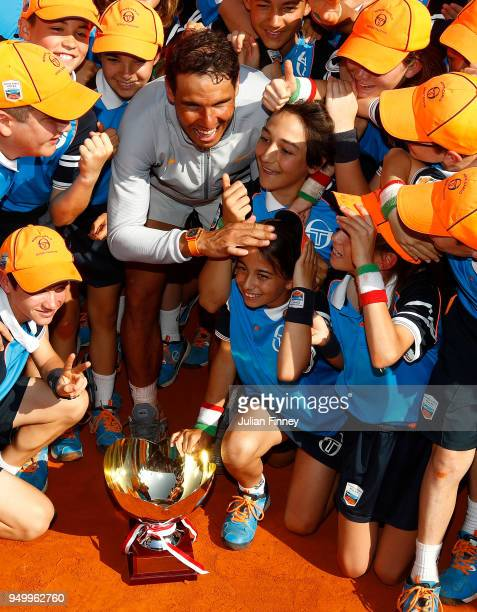 Rafael Nadal of Spain celebrates with the ball boys and girls after winning the Monte Carlo Rolex Masters against Kei Nishikori of Japan during day...