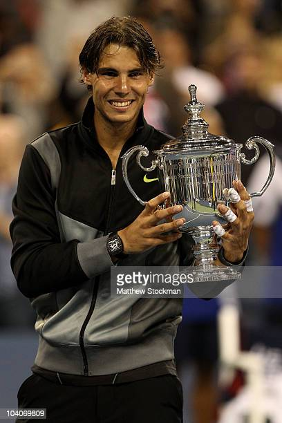 Rafael Nadal of Spain celebrates with the championship trophy after defeating Novak Djokovic of Serbia to win the men's singles final on day fifteen...