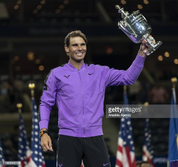 Rafael Nadal of Spain celebrates with the championship trophy after winning his Men's Singles final match against Daniil Medvedev of Russia on day...
