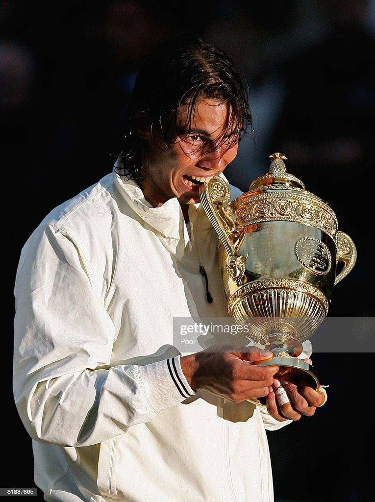 Rafael Nadal of Spain celebrates with the Championship trophy after winning the men's singles Final match against Roger Federer of Switzerland on day thirteen of the Wimbledon Lawn Tennis Championships at the All England Lawn Tennis and Croquet Club on July 6, 2008 in London, England.