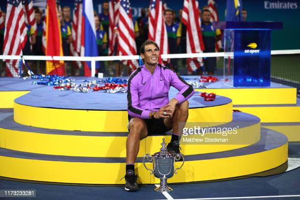 Rafael Nadal of Spain celebrates with the championship trophy during the trophy presentation ceremony after winning his Men's Singles final match...