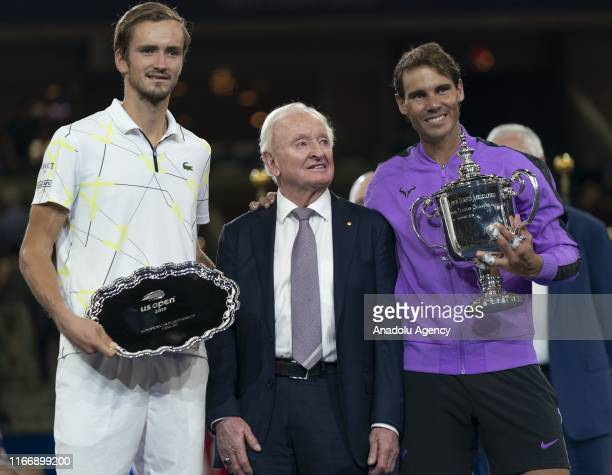 Rafael Nadal of Spain celebrates with the championship trophy alongside tennis champion Rod Laver during the trophy presentation ceremony after...
