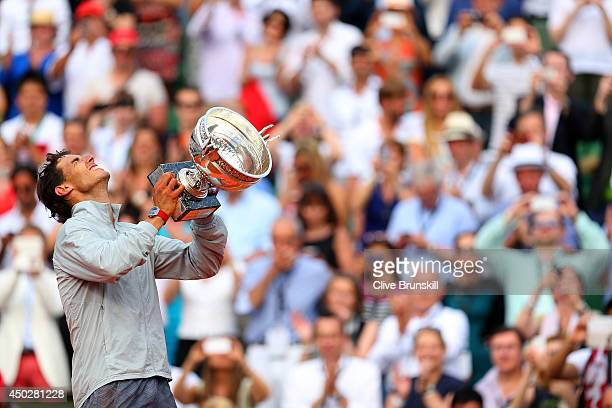 Rafael Nadal of Spain celebrates with the Coupe de Mousquetaires after victory in his men's singles final match against Novak Djokovic of Serbia on...