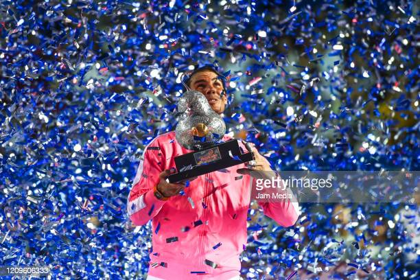 Rafael Nadal of Spain celebrates with the trophy after his victory during the singles match as part of the ATP Mexican Open 2020 Day 6 at Princess...
