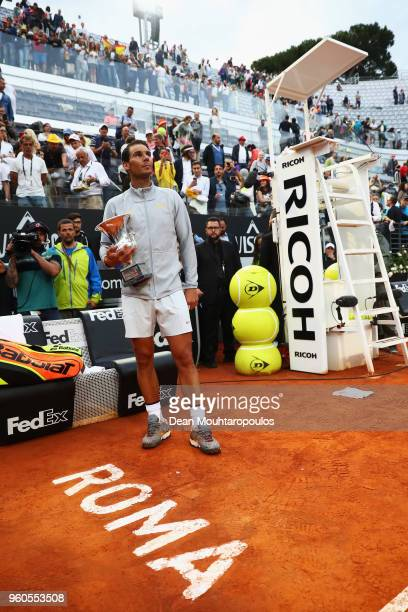 Rafael Nadal of Spain celebrates with the trophy after victory in his Mens Final match against Alexander Zverev of Germany during day 8 of the...