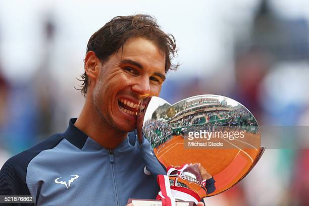 Rafael Nadal of Spain celebrates with the trophy after victory in the singles final match against Gael Monfils of France during day eight of the...