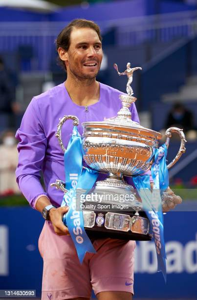 Rafael Nadal of Spain celebrates with the trophy after winning his Men's Singles final match against Stefanos Tsitsipas of Greece on day seven of the...