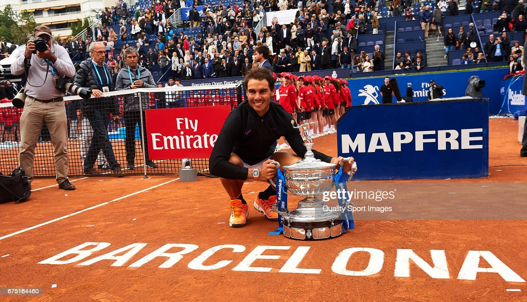 Rafael Nadal of Spain celebrates with the trophy after winning his match and become Champion of the Barcelona Open Banc Sabadell against Dominic Thiem of Austria during the Day 6 of the Barcelona Open Banc Sabadell at the Real Club de Tenis Barcelona on April 29, 2017 in Barcelona, Spain.