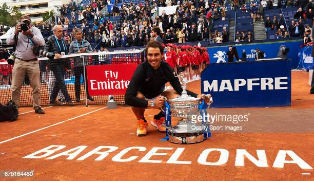 Rafael Nadal of Spain celebrates with the trophy after winning his match and become Champion of the Barcelona Open Banc Sabadell against Dominic...