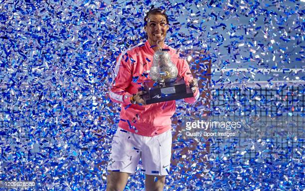Rafael Nadal of Spain celebrates with the trophy after winning Mexican Open against Taylor Fritz of United States during day six of the ATP Mexican...