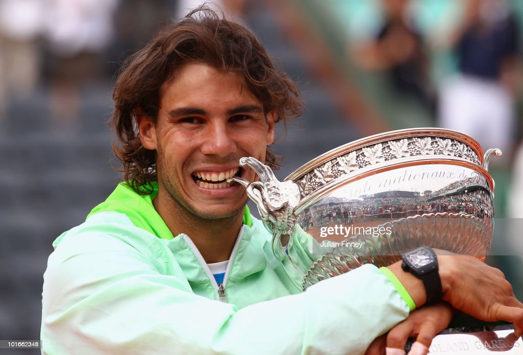 Rafael Nadal of Spain celebrates with the trophy after winning the men's singles final match between Rafael Nadal of Spain and Robin Soderling of Sweden on day fifteen of the French Open at Roland Garros on June 6, 2010 in Paris, France.