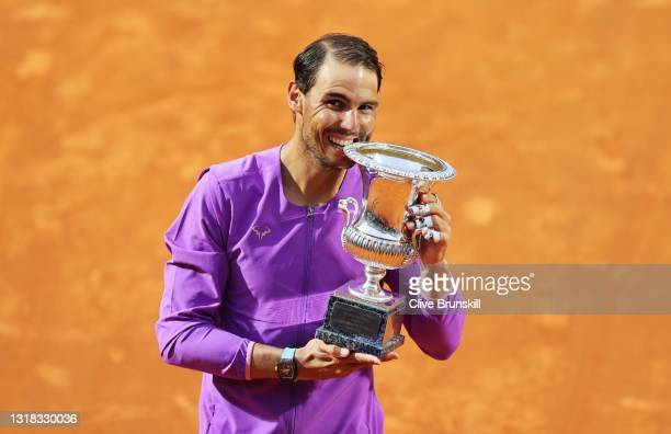 Rafael Nadal of Spain celebrates with the trophy after winning the final over Novak Djokovic of Serbia during the men's final at Foro Italico on May...