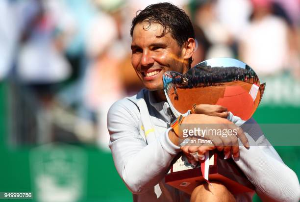 Rafael Nadal of Spain celebrates with the trophy after winning the Monte Carlo Rolex Masters against Kei Nishikori of Japan during day eight of ATP...